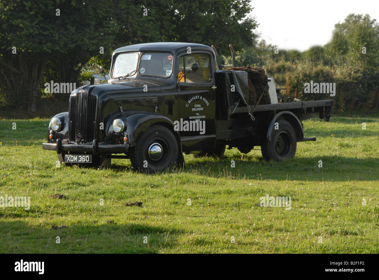 stationery  historic coal lorry in field - Stock Image