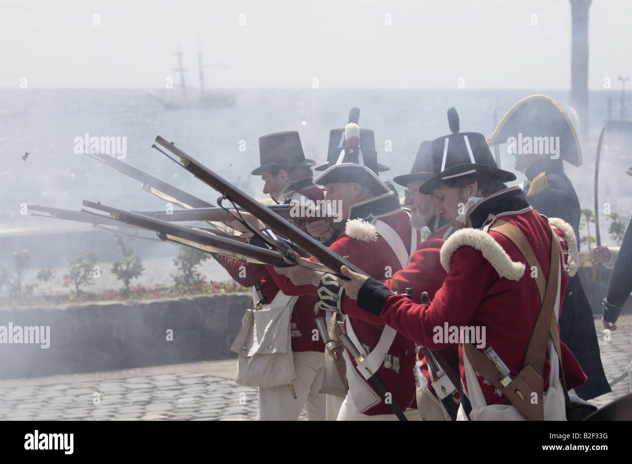 A group of British Royal Marine aiming and firing during a reenactment of the 1797 battle of Santa Cruz, Tenerife Stock Photo