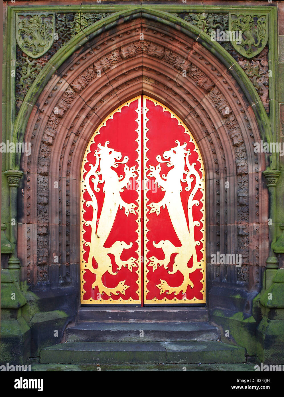 Gilded west door with lions. St Giles church, Cheadle, Staffordshire, designed in the Gothic Revival style by A.W.N. - Stock Image