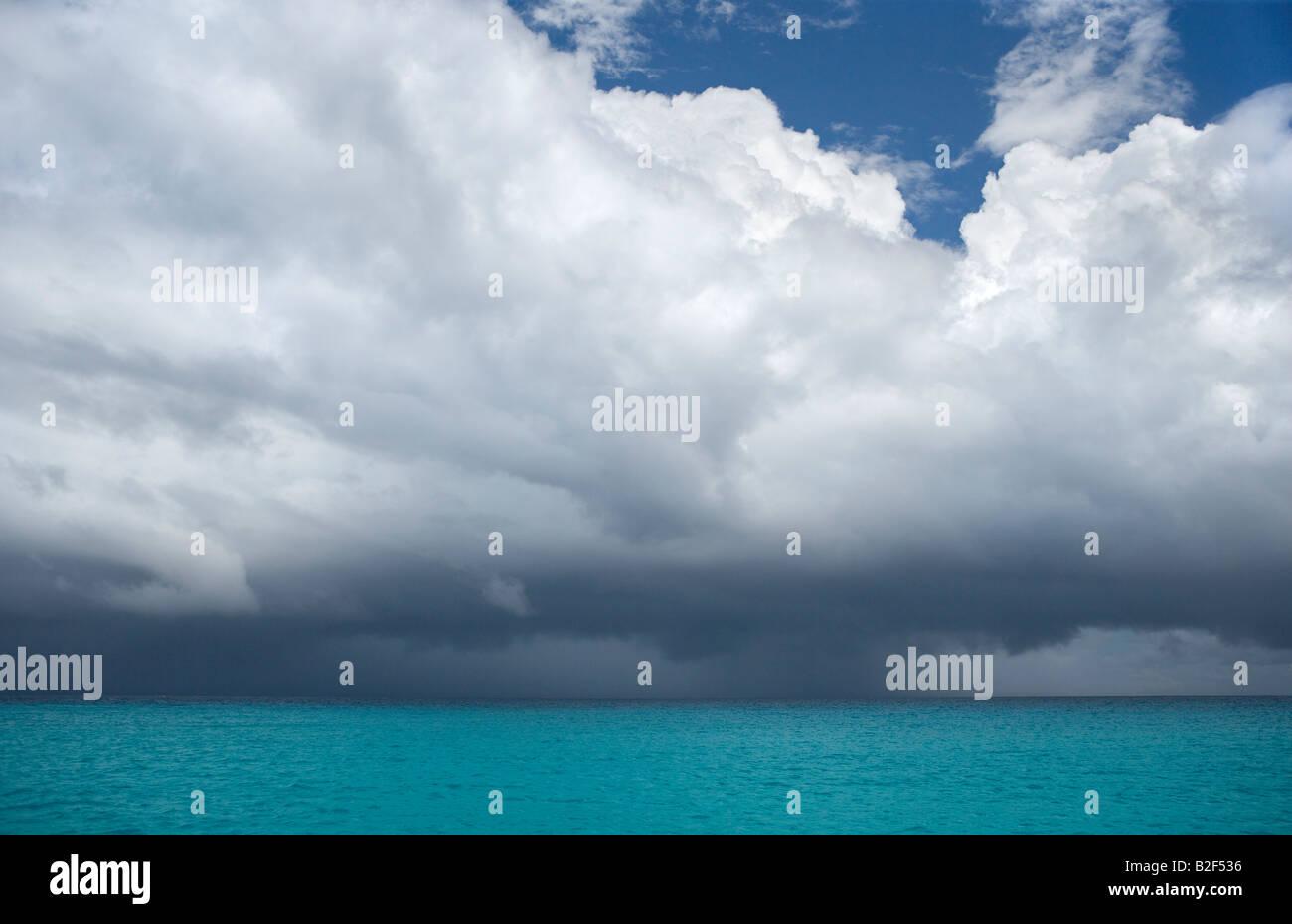 Dark rain clouds forming over the Caribbean Sea near St Martin in the Leeward Islands - Stock Image