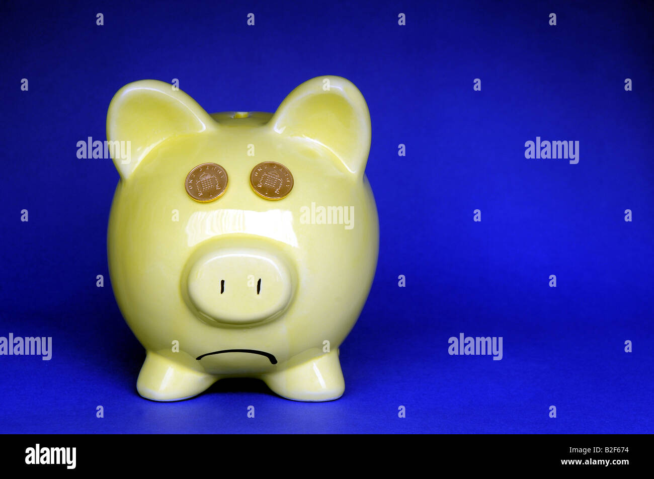 GLUM LOOKING BRITISH PIGGYBANK WITH DOWNTURNED MOUTH, RE RECESSION SAVINGS LOANS INCOMES MORTGAGES COSTS OF LIVING - Stock Image