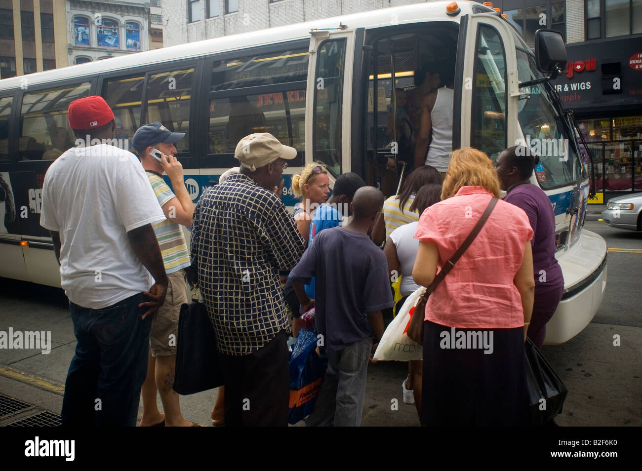 Commuters board a bus in downtown Brooklyn in New York Stock Photo