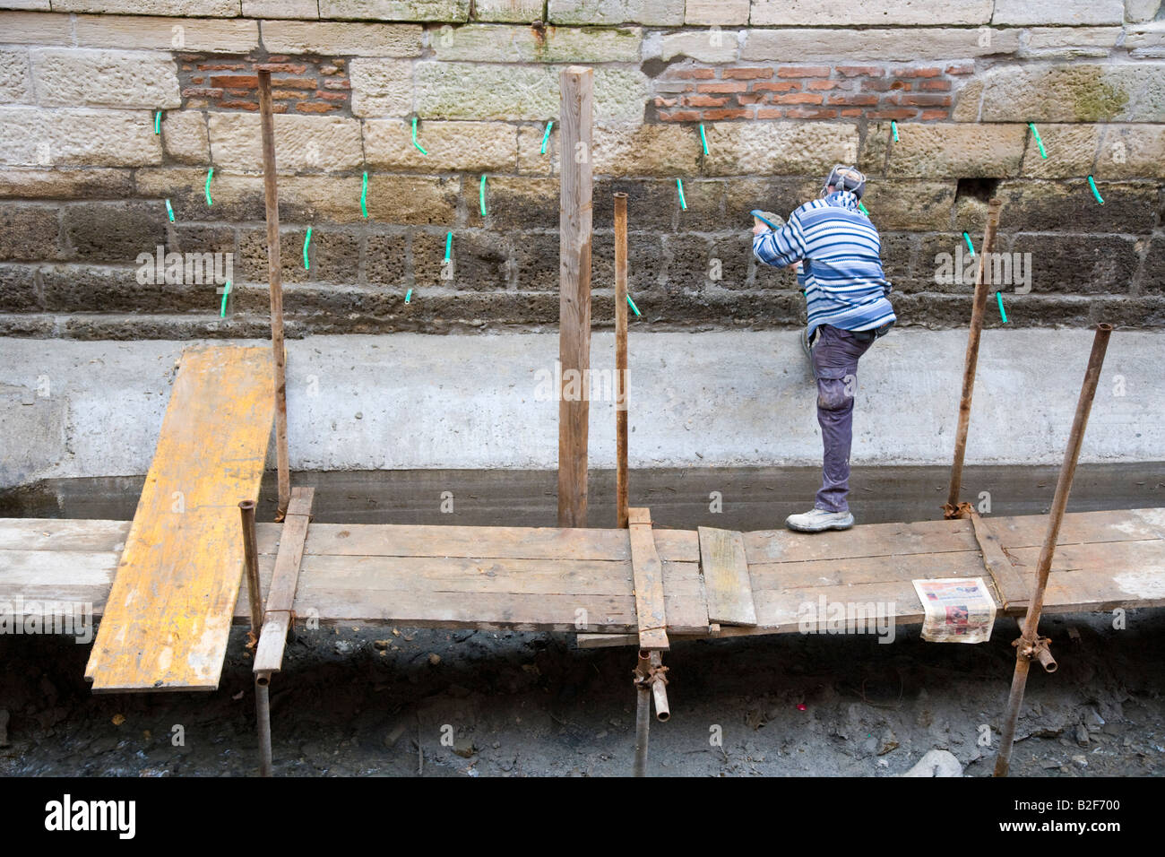 Canal repair works to drained canals Venice Italy - Stock Image