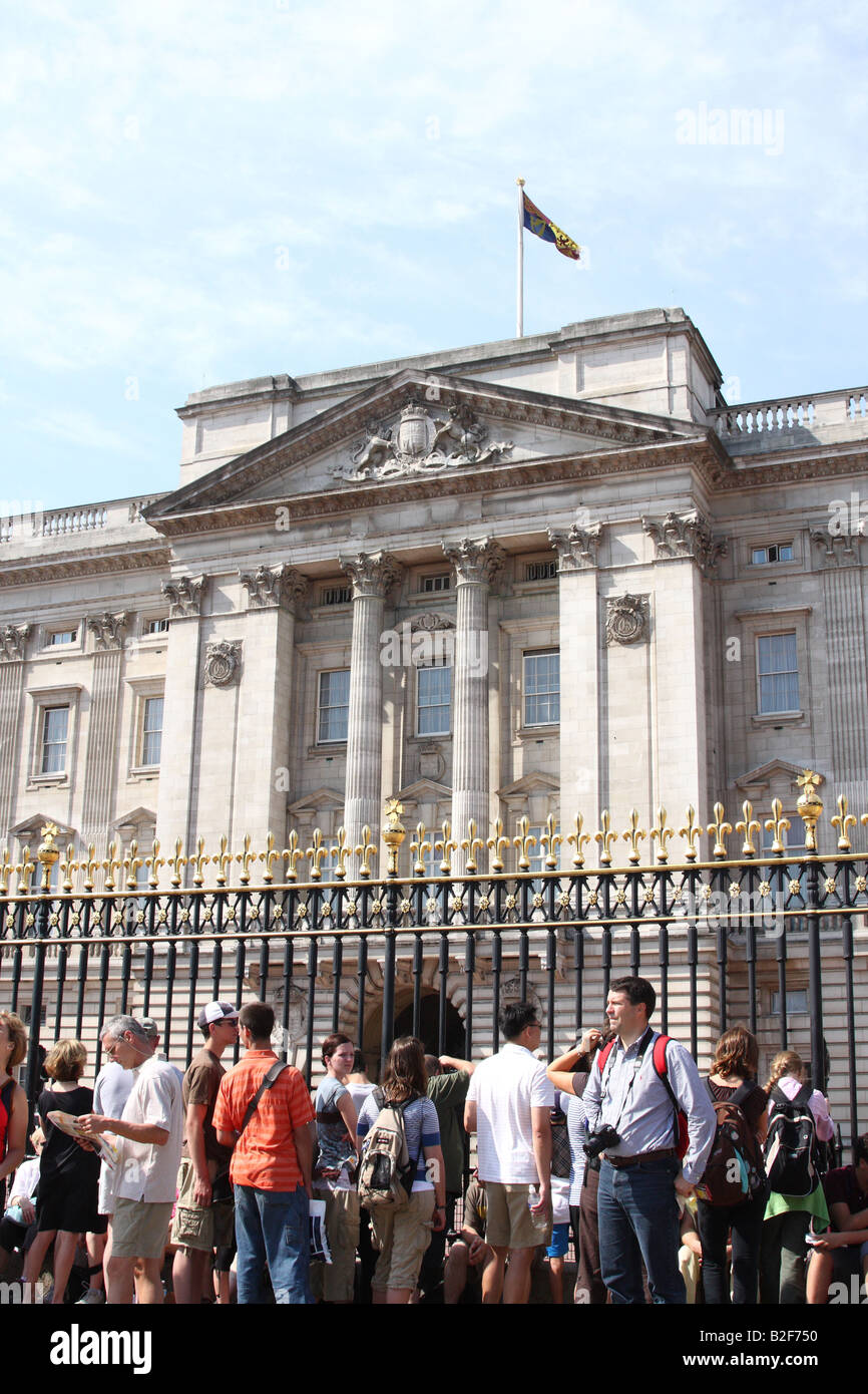 Buckingham Palace, London. The official residence of Queen Elizabeth II with flag flying to signify the monarch Stock Photo