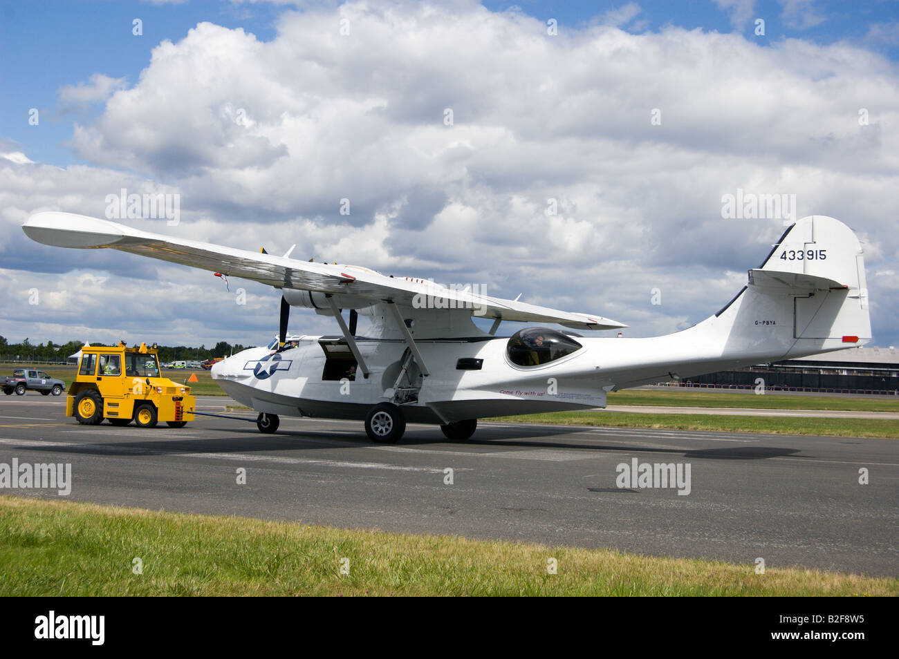 A Consolidated Catalina taxiing onto the runway - Stock Image