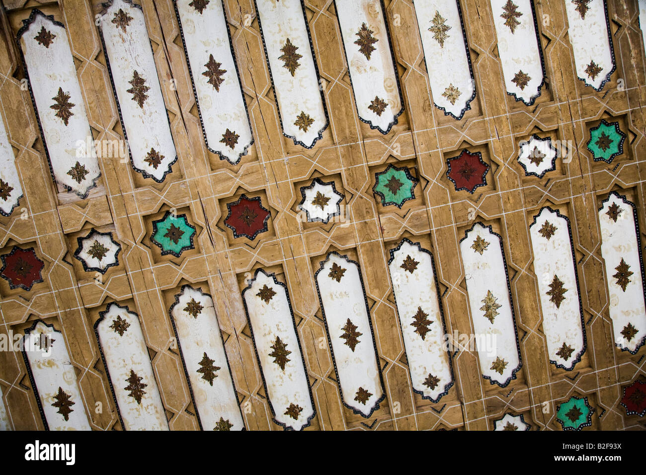 SPAIN Salamanca Mudejar design on coffered ceiling of walkway at University of Salamanca stars inlaid between strips - Stock Image