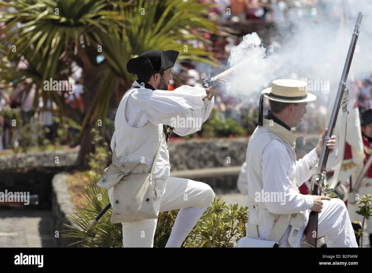 A British Navy sailor fireing his rifle during a reenactment of the 1797 battle of Santa Cruz, Tenerife Stock Photo