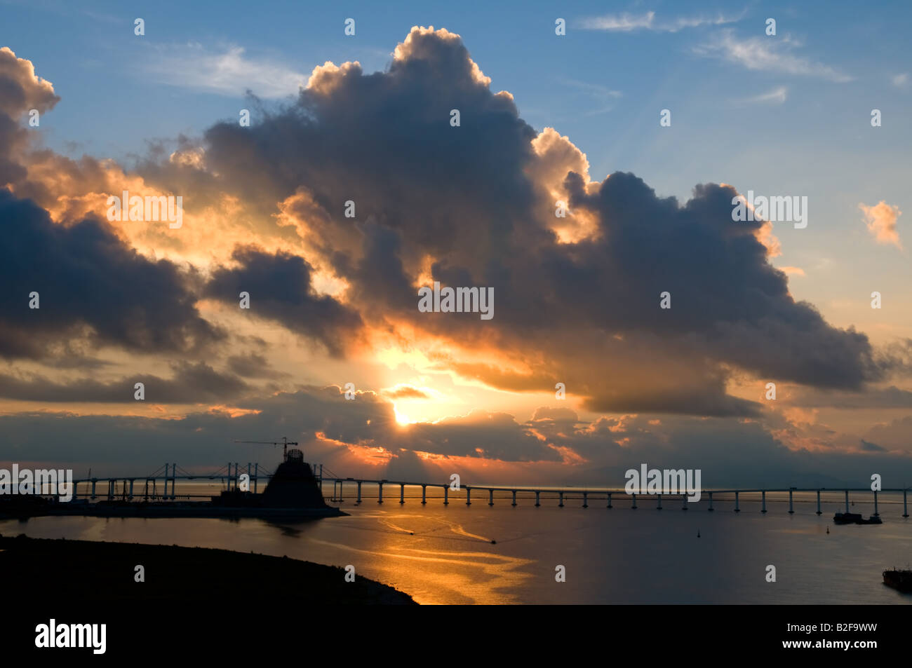 The panorama of friendship birdge and the under constructing Macau Science Center at daybreak - Stock Image