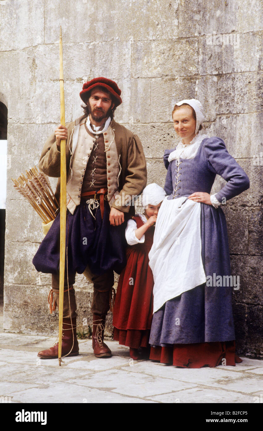 Tudor historical re-enactment family group man woman child English 16th century authentic costume living history - Stock Image