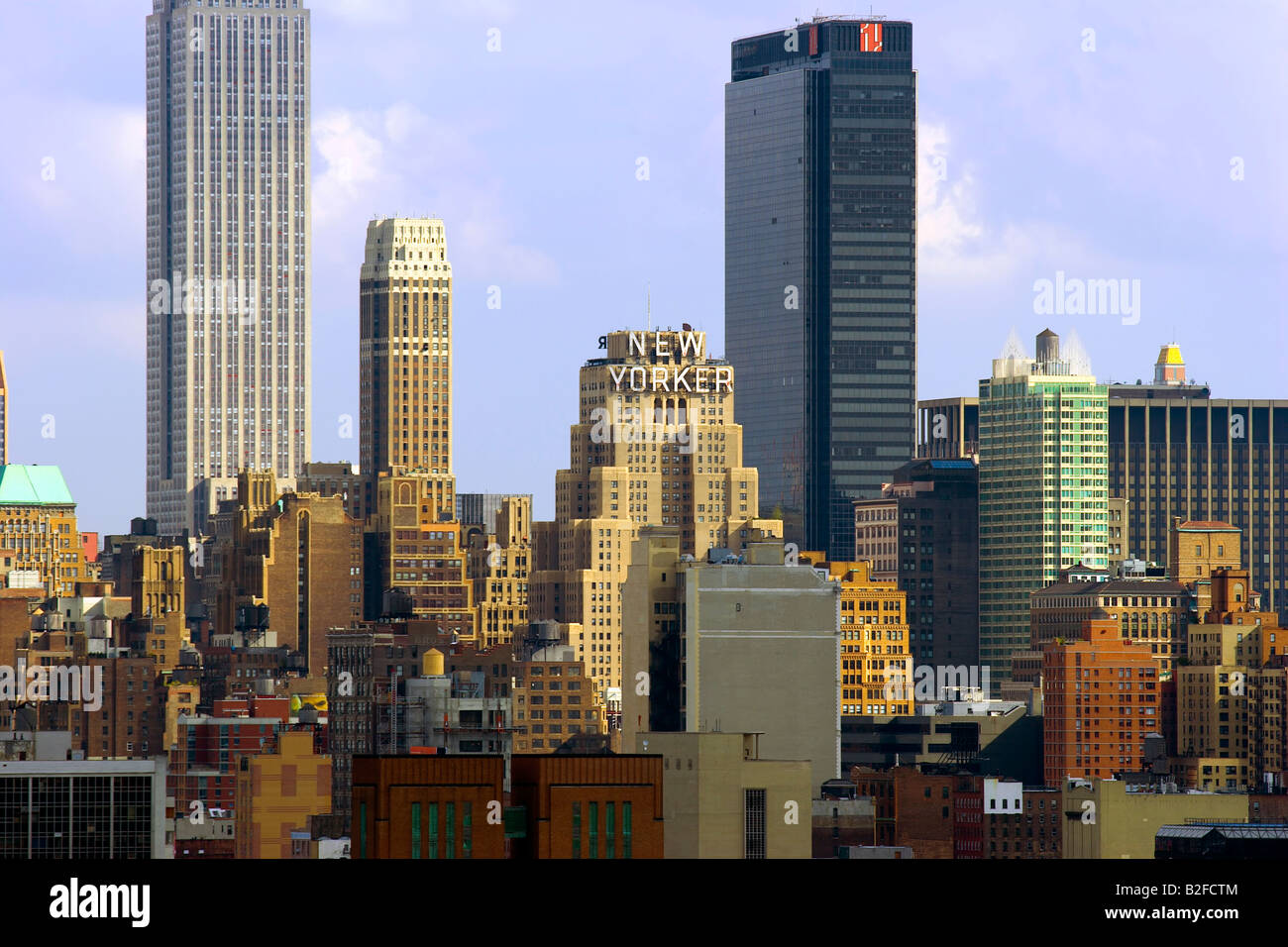 new york city manhattan buildings day time clouds blue sky