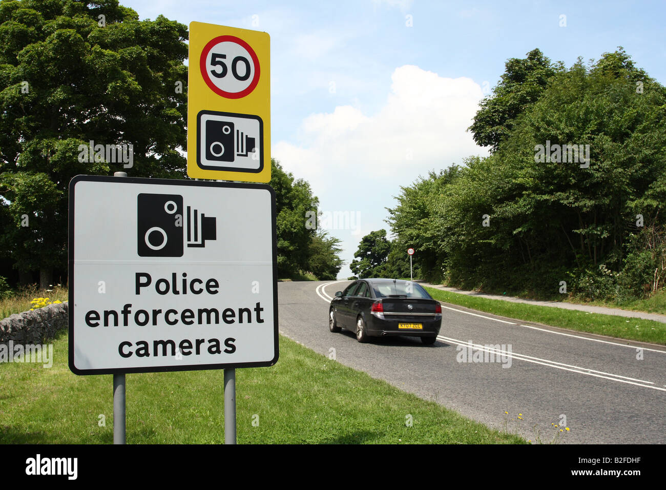 Roadside speed restriction sign on the A6 in Derbyshire, England, U.K. - Stock Image