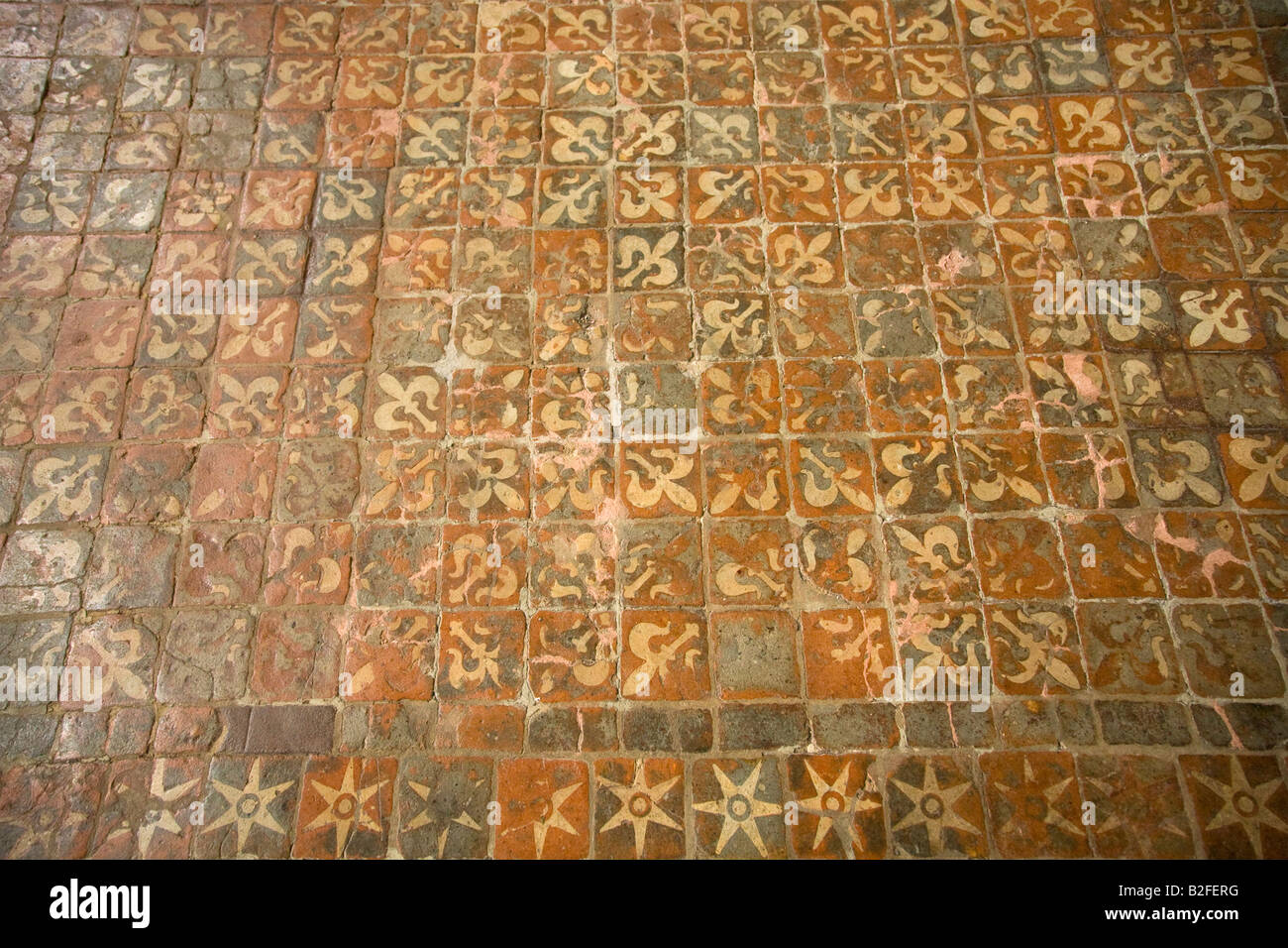 Medieval floor tiles interior of Winchester Cathedral Hampshire England United Kingdom GB Great Britain British - Stock Image