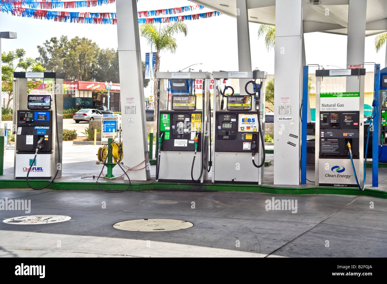 Pumps for propane biodiesel ethanol and natural gas at a San Diego filling station offer an alternative fuel for - Stock Image