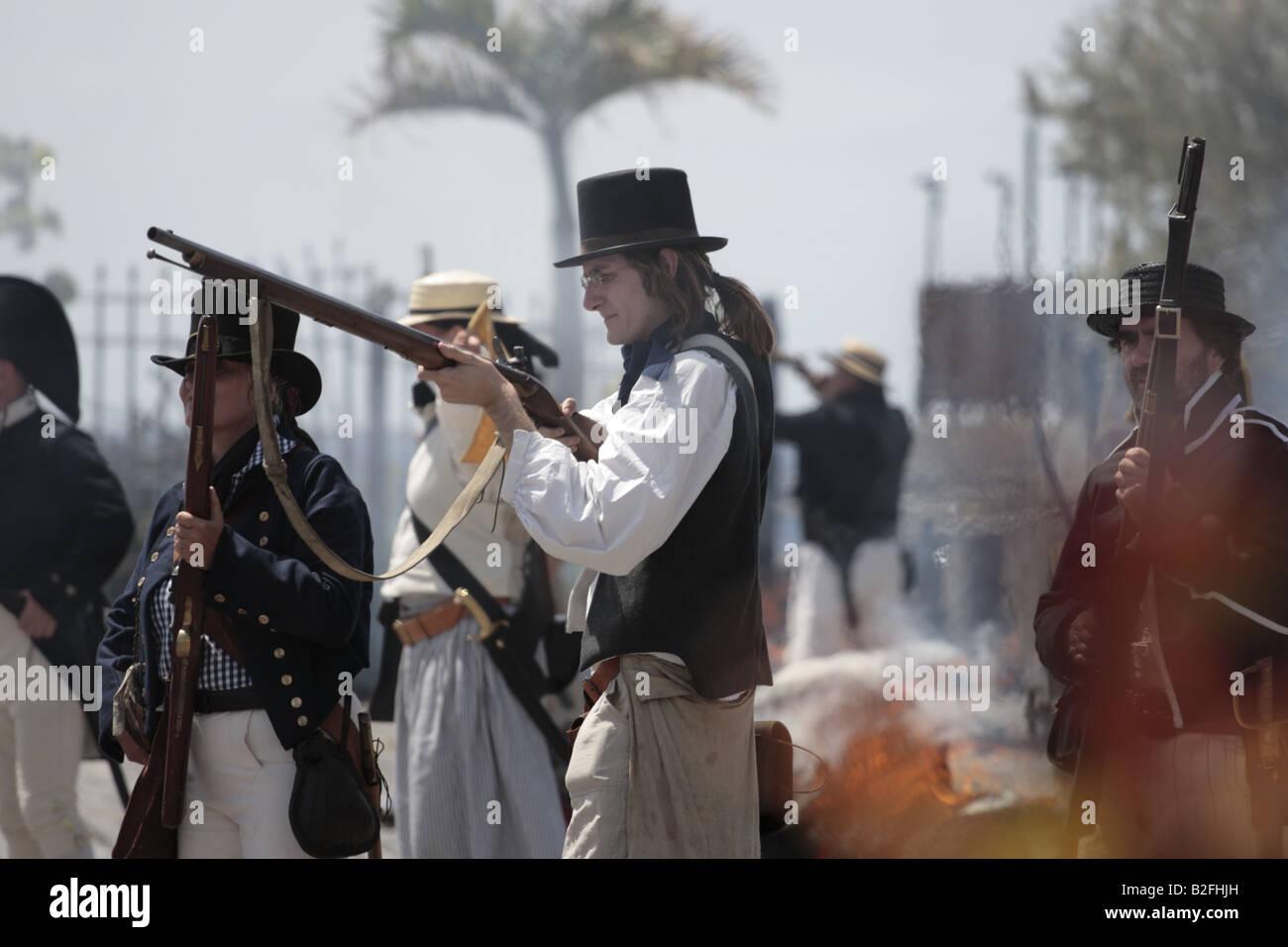 A British Navy sailor loading his rifle during a reenactment of the 1797 battle of Santa Cruz, Tenerife Stock Photo