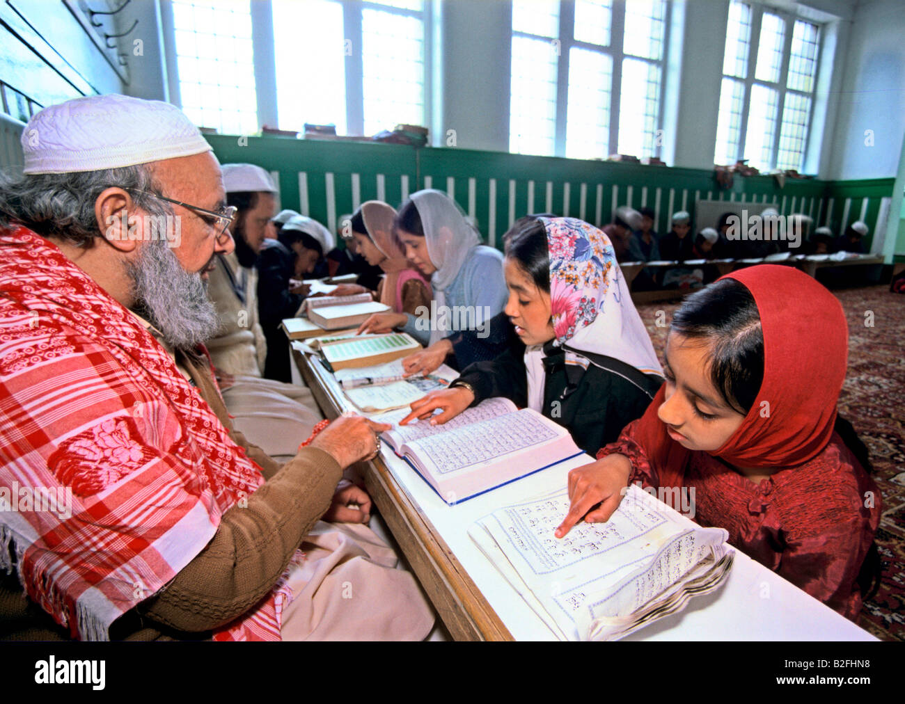 girls studying the qur'an at an islamic school in bradford - Stock Image