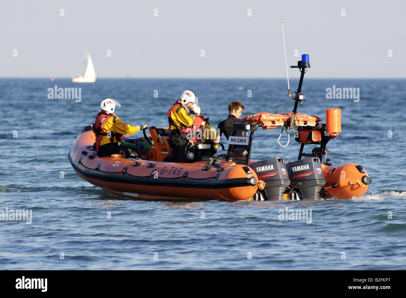 An RNLI inflatable RIB inshore lifeboat used for local water rescues in calm waters - Stock Image