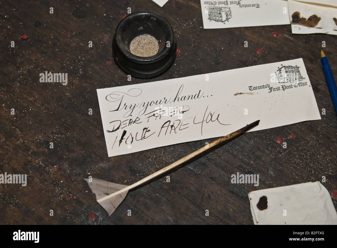 Quill pen hand written note and drying sand still life - Stock Image