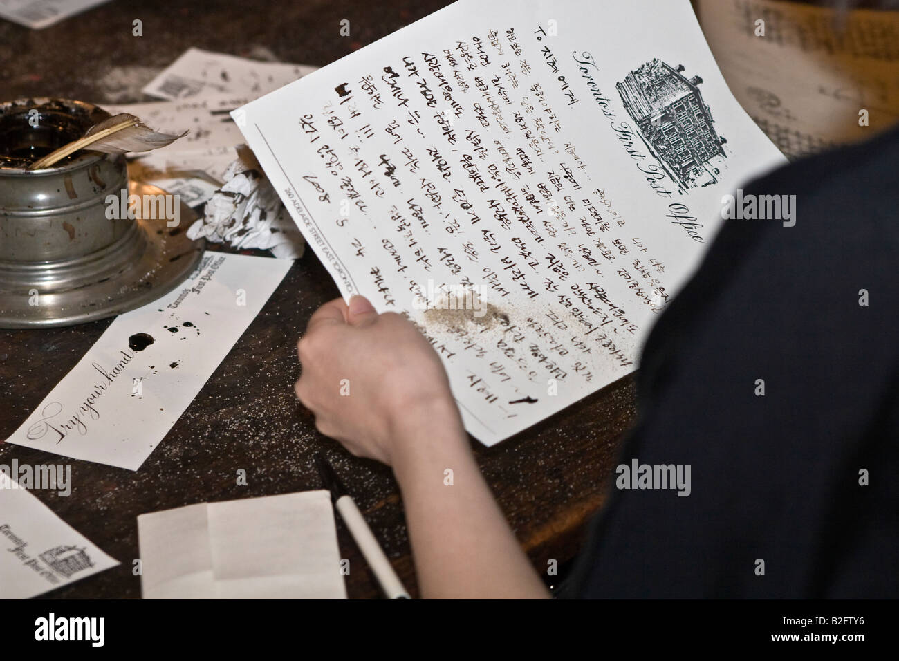 Drying letter written with a quill pen and ink - Stock Image