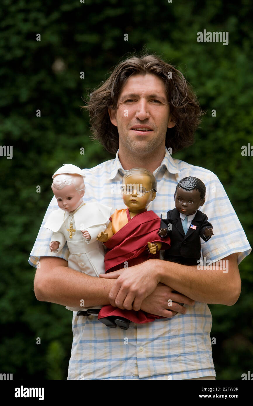 The dolls doctor Marcel Offermann with his dolls the Pope Benedict the Dalai Lama and Barack Obama - Stock Image