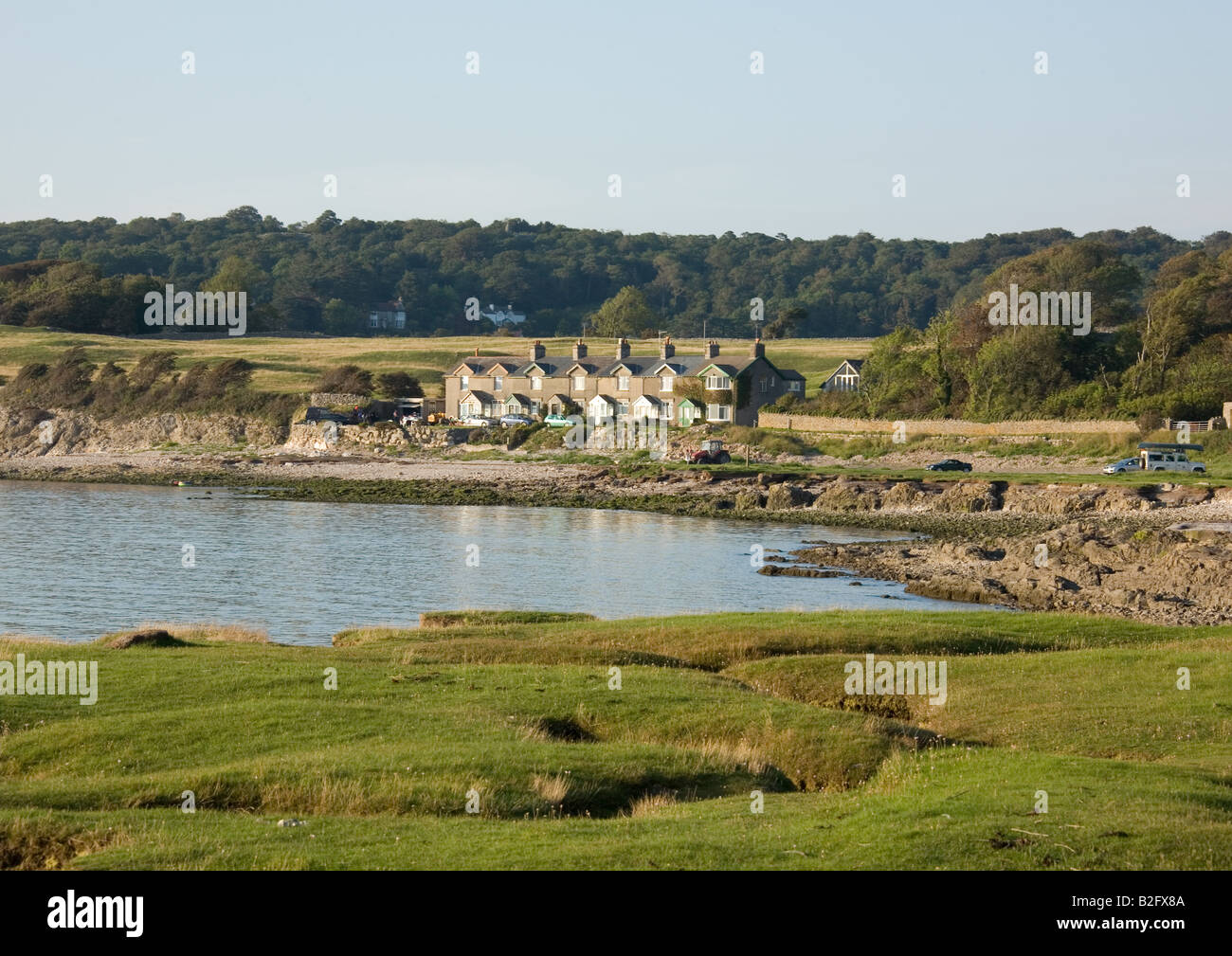 A summer evening looking over the intertidal sandflats and mudflats of Morecambe Bay at Silverdale Bay, Carnforth, Stock Photo