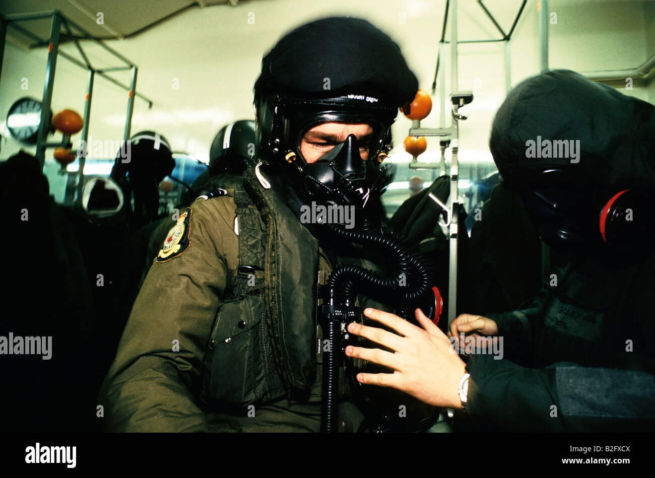 NEXT BATTLE OF BRITAIN FIGHTER PILOT ON SCRAMBLE PUTTING ON CHEMICAL GERM WARFARE SUIT 1988 - Stock Image
