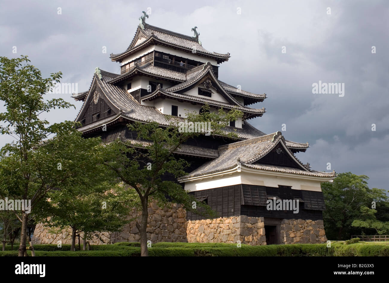 Matsue Castle in Shimane Prefecture is one of only a few remaining original wooden feudal castles in Japan - Stock Image