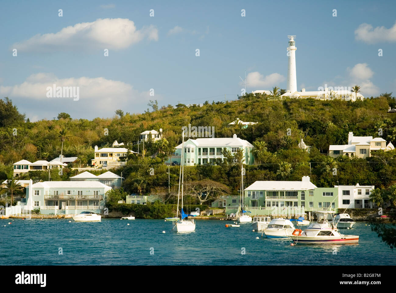 Boats anchored in Jew s Bay Southampton Bermuda with Gibbs Hill Lighthouse in the background. - Stock Image