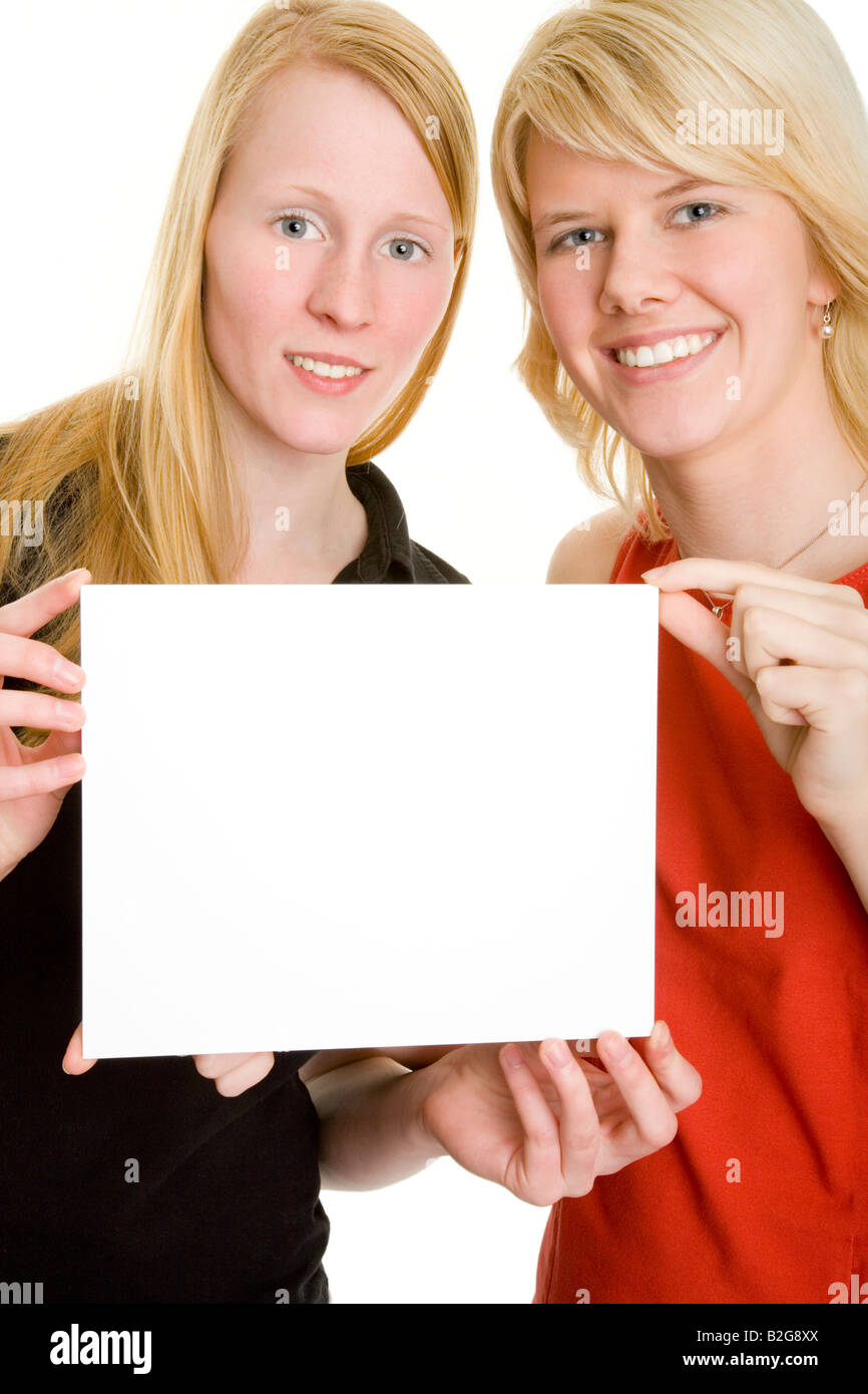 pair couple young women paper sign Stock Photo