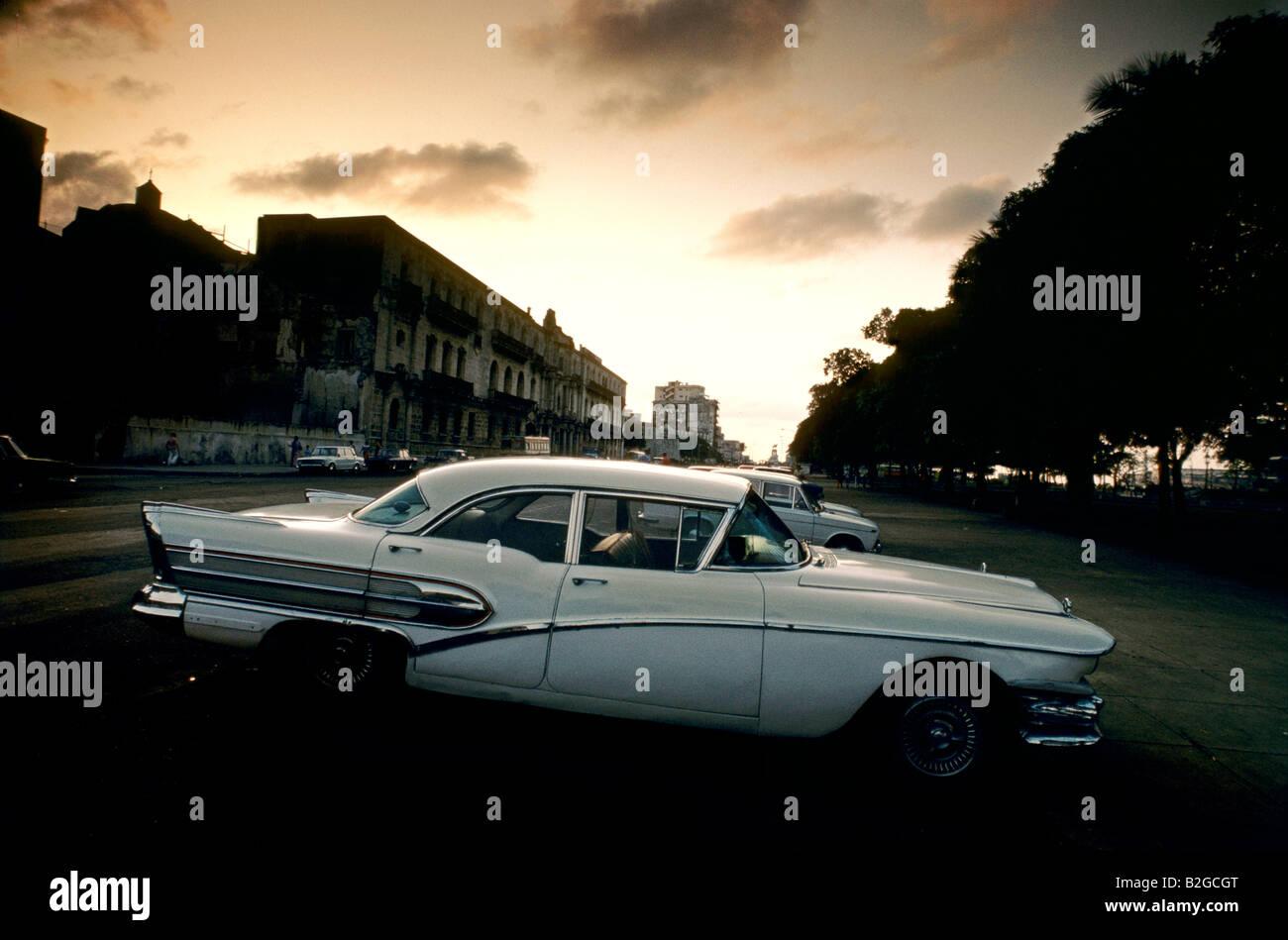 White classic American car at sunset, Havana, Cuba - Stock Image