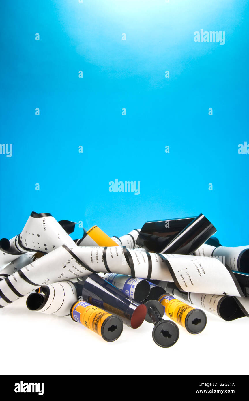 time for film (material, analog) is over - Opened rolls of 120 medium format films cutout blue background yellow - Stock Image