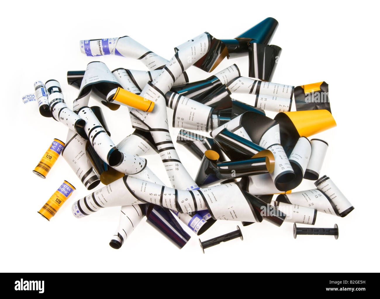 time for film (material, analog) is over - Opened rolls of 120 medium format films  yellow white black - Stock Image