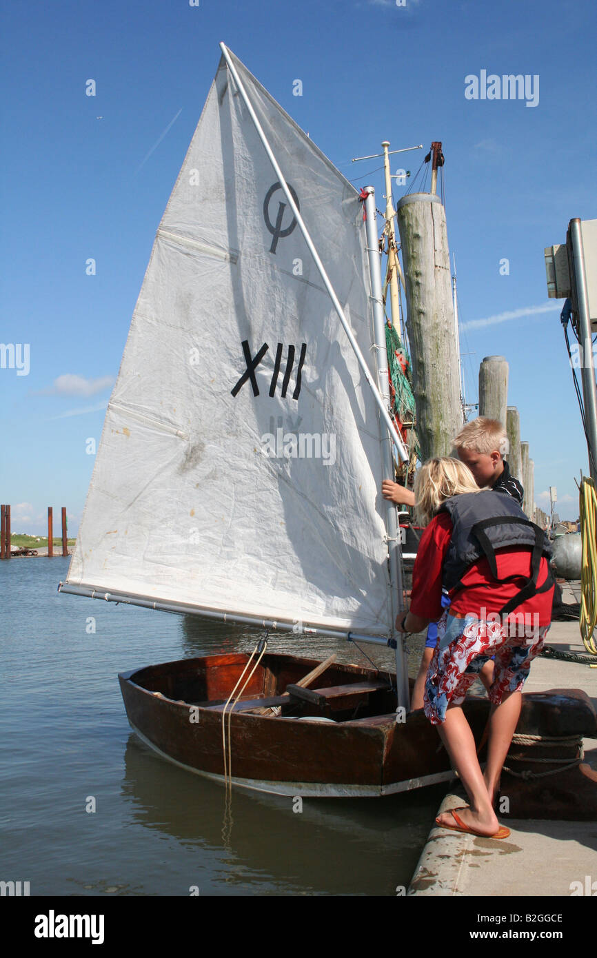 sailing trip boat child pier dinghy jolle kid Stock Photo