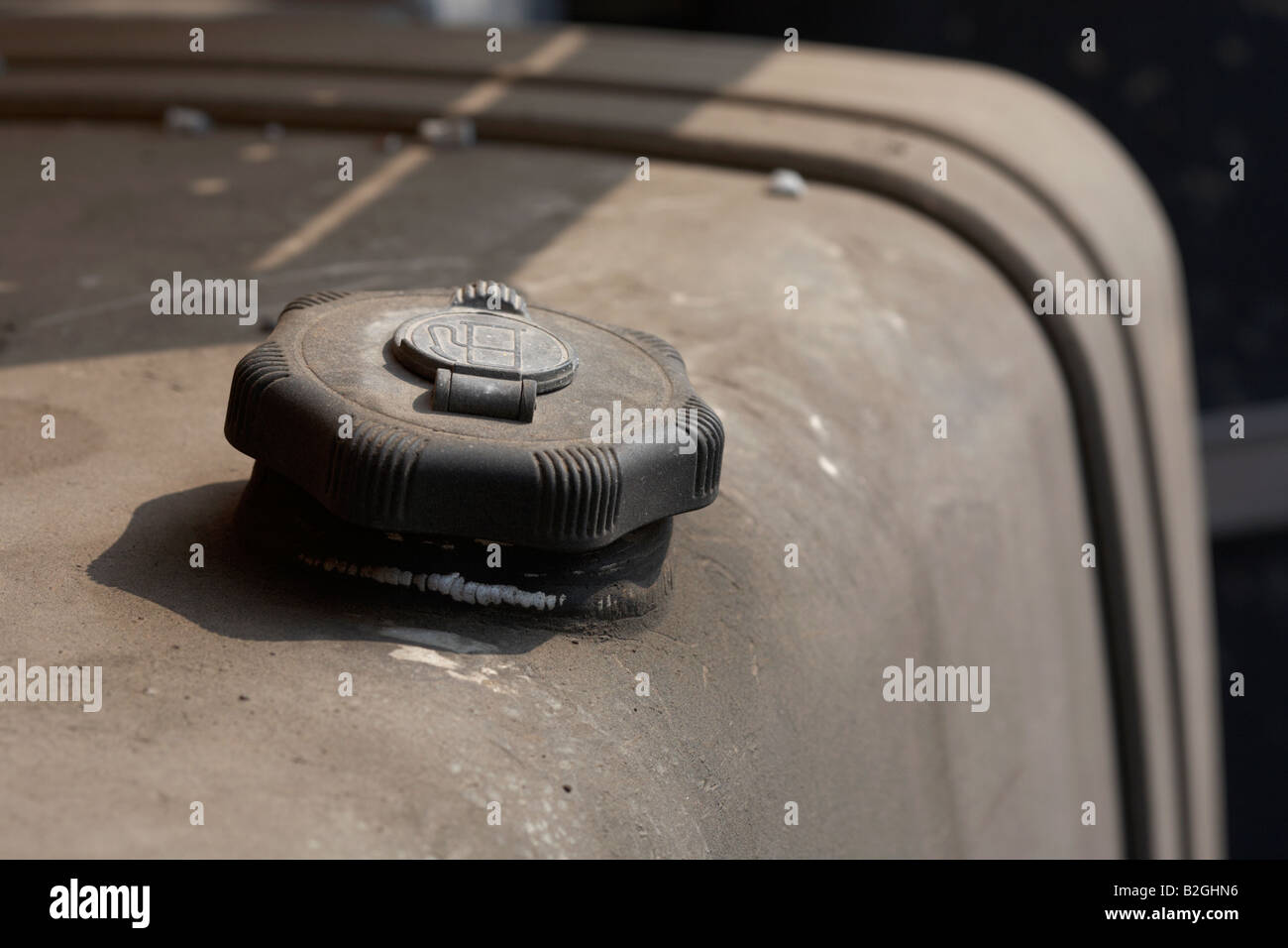 fuel filler cap on a large diesel tank attached to a truck - Stock Image