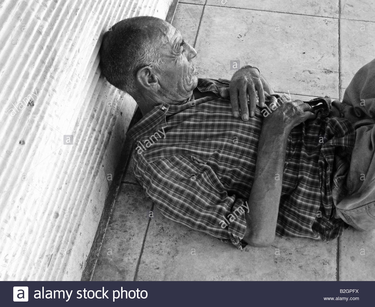 Homeless person sleeping in the old central bus station area in Tel Aviv, Israel - Stock Image