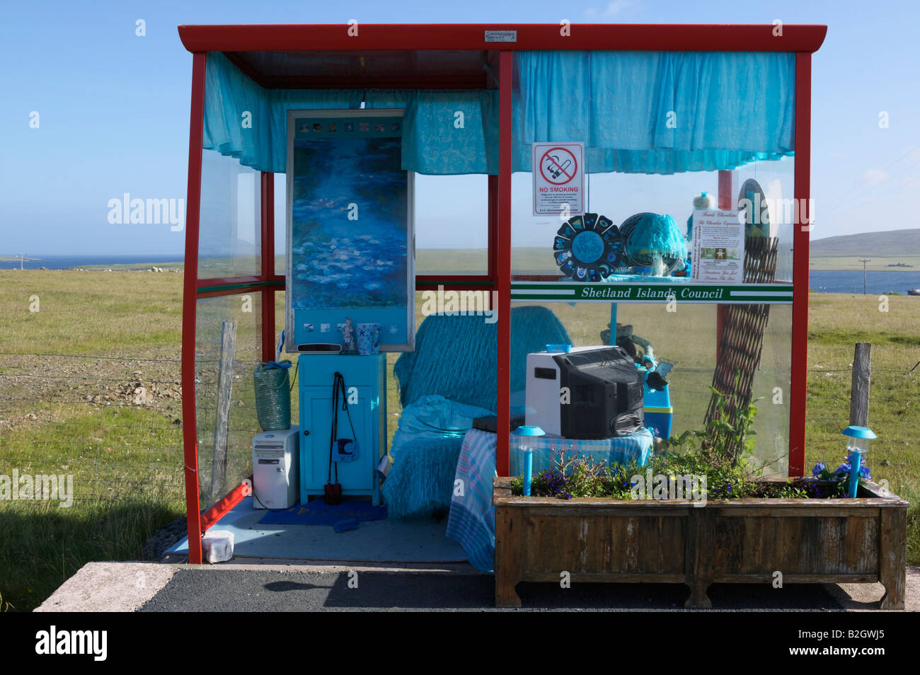 Blue themed and decorated bus stop near Baltasound, Unst, Shetland Isles, Scotland, UK. Known as the Unst bus shelter - Stock Image