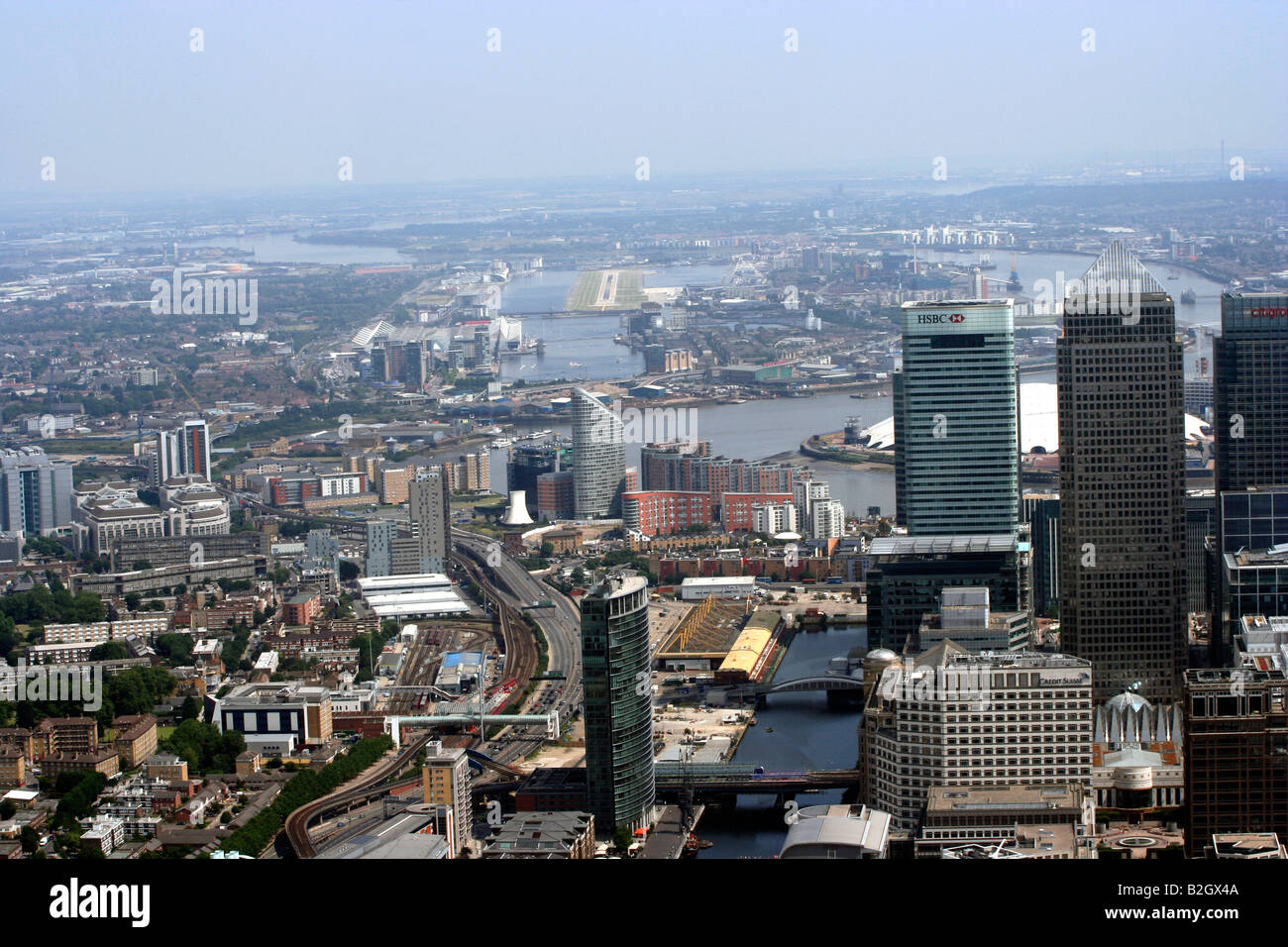 Aerial view of Canary Wharf London Docklands with London City Airport in the Distance - Stock Image