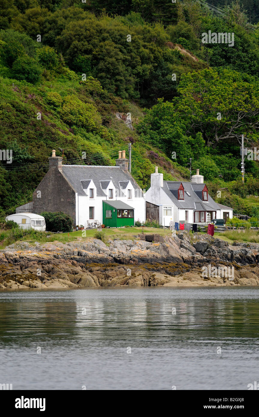 Croft house by the shore, Gairloch, Wester Ross, North West Highland Scotlandon the north coast 500 route - Stock Image