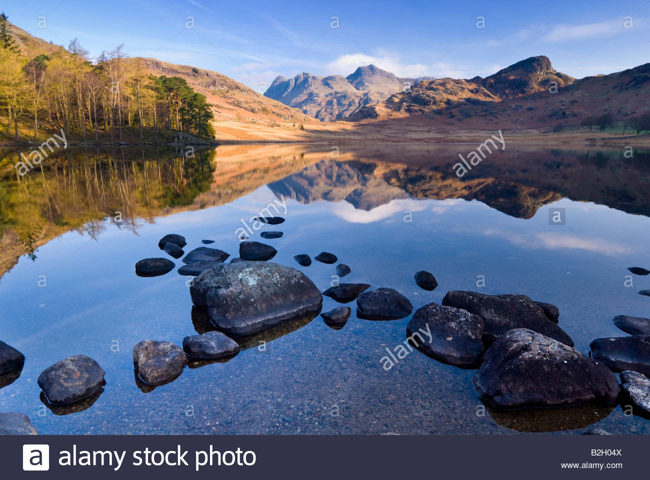 The Langdale Pikes reflected in the waters of Blea Tarn, Lake District National Park, Cumbria, England, UK. - Stock Image