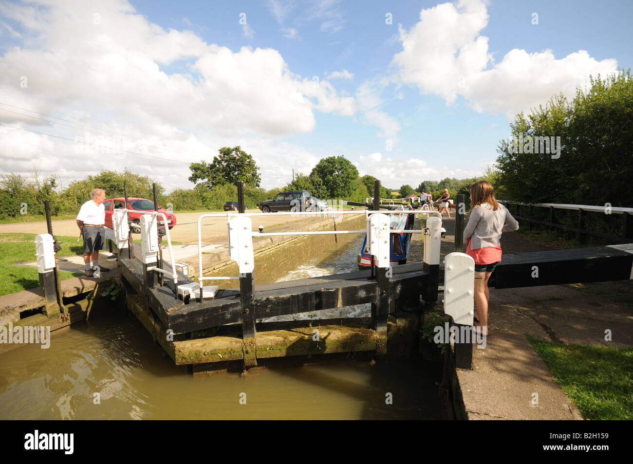 Narrow Boats at Stoke Bruerne Lock Flight on the Grand Union Canal England - Stock Image