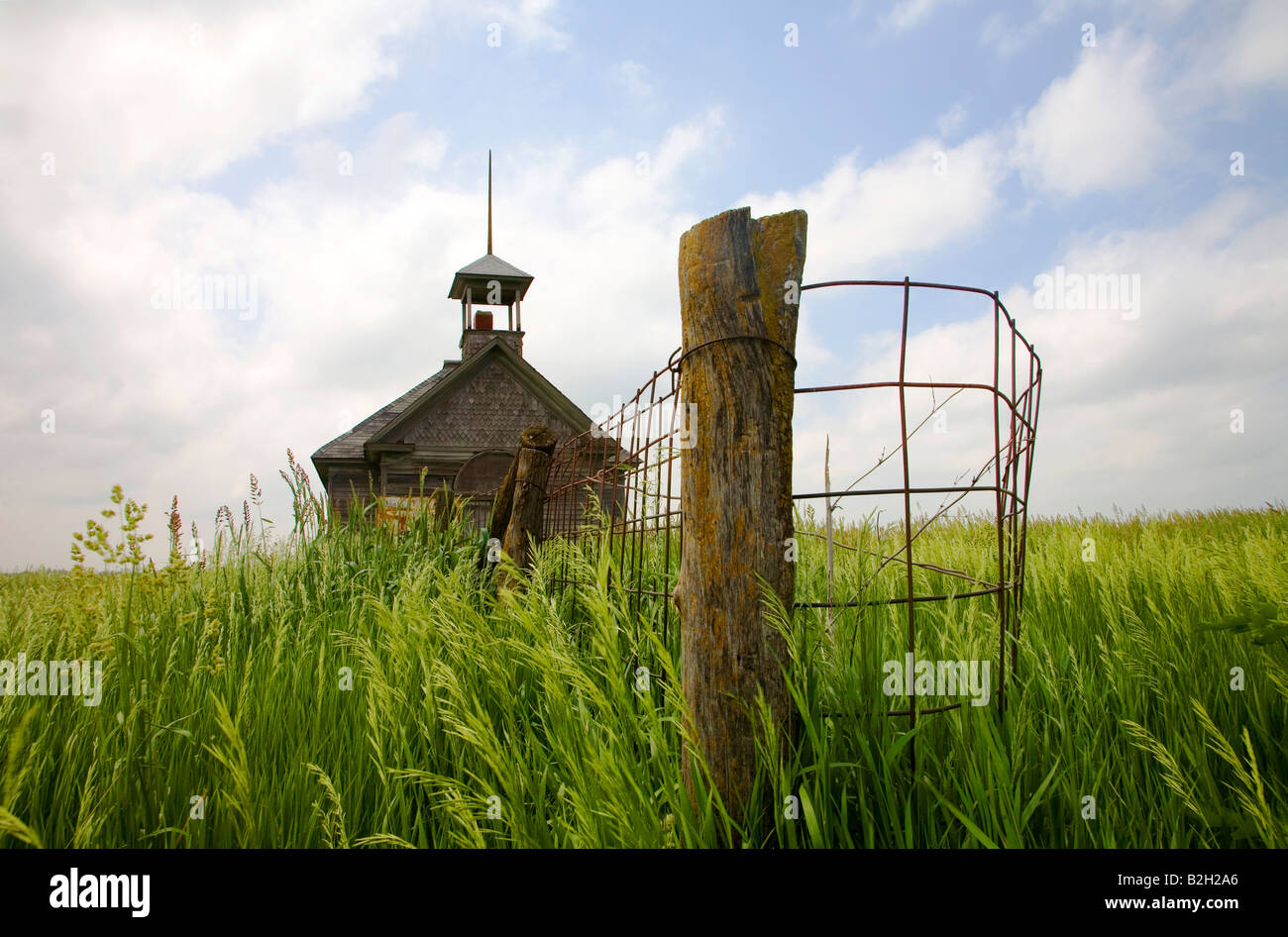 One room school house in the middle of fiield of tall grass Iowa USA - Stock Image