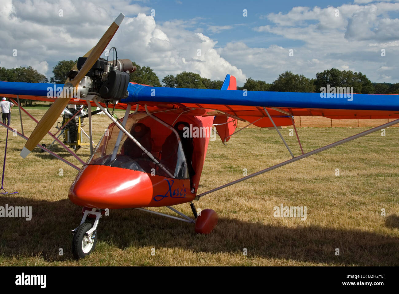 Stock photo of a single engined propellor driven light aircraft in a field - Stock Image