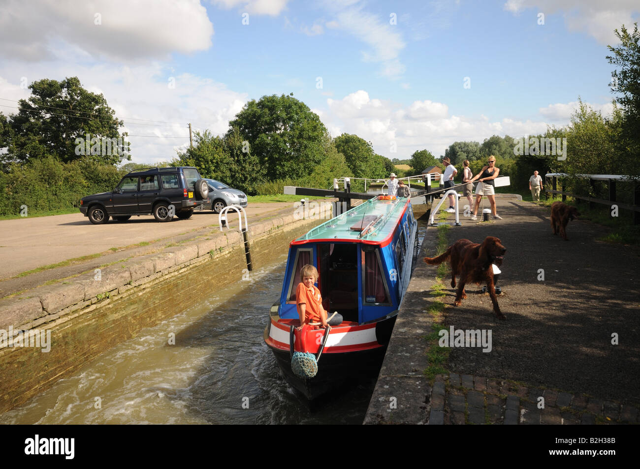 Narrow Boats at Stoke Bruerne Lock Flight on the Grand Union Canal England narrow boat in lock - Stock Image