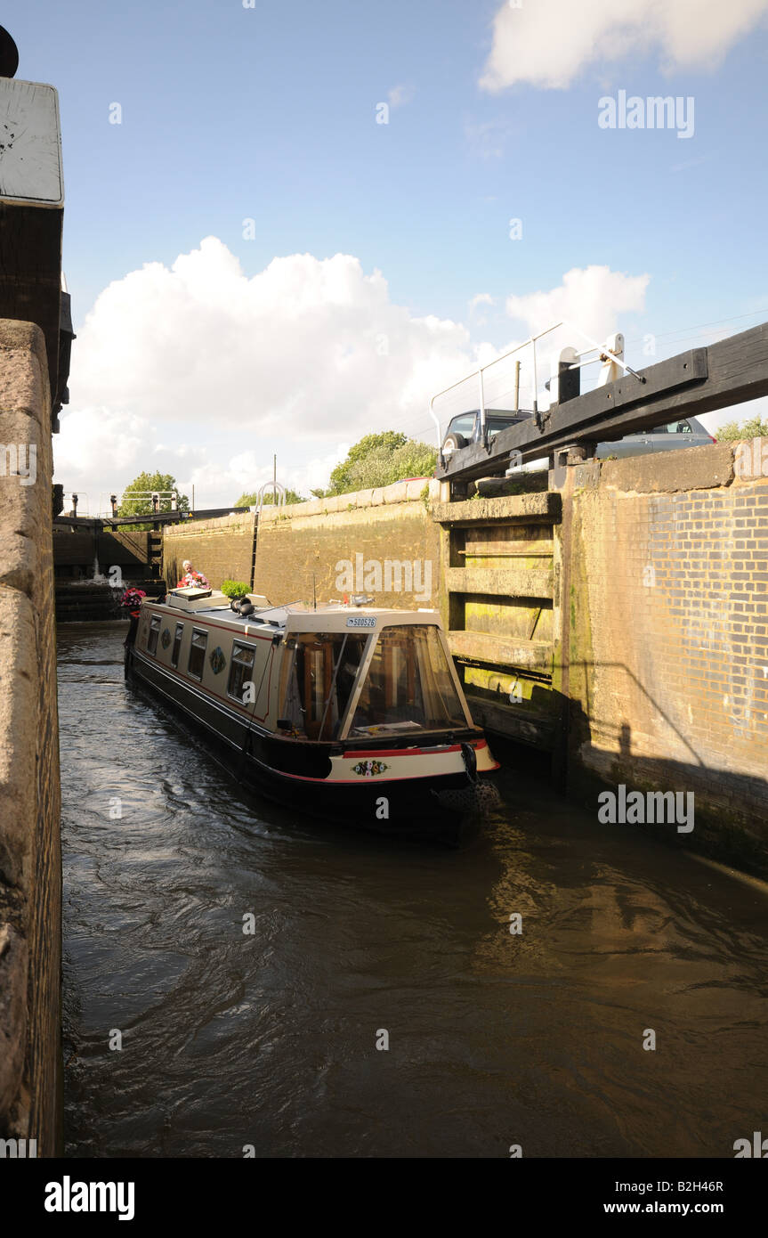 Narrow Boats at Stoke Bruerne Lock Flight on the Grand Union Canal England narrow boat leaving Lock - Stock Image