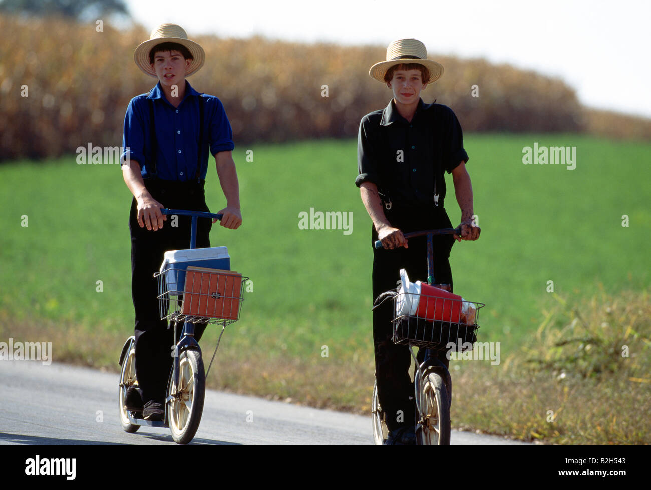 Amish children in traditional plain clothing on scooters for Lancaster county motors used