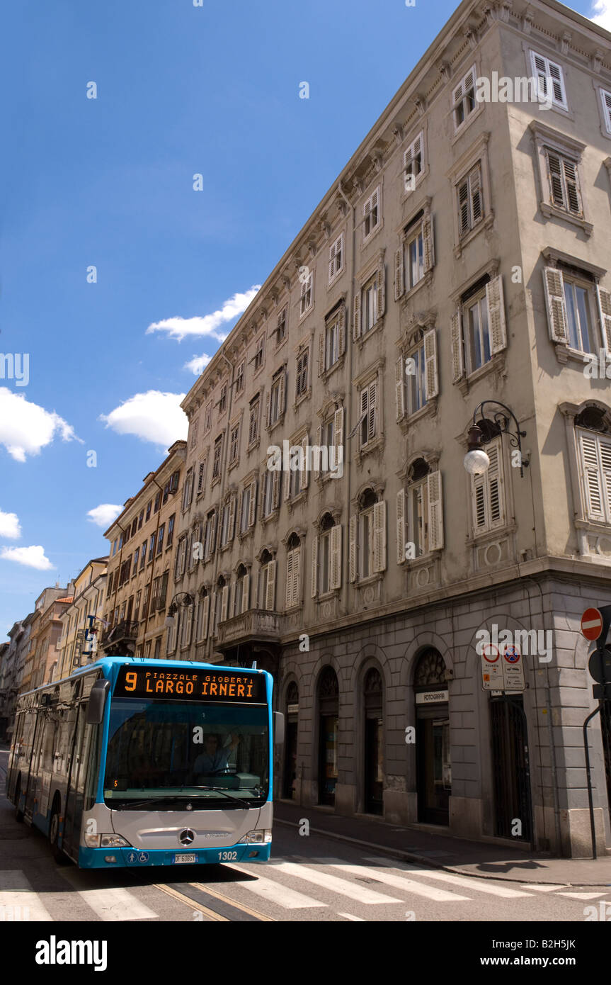 A bus travels down a street in Trieste Italy Europe - Stock Image