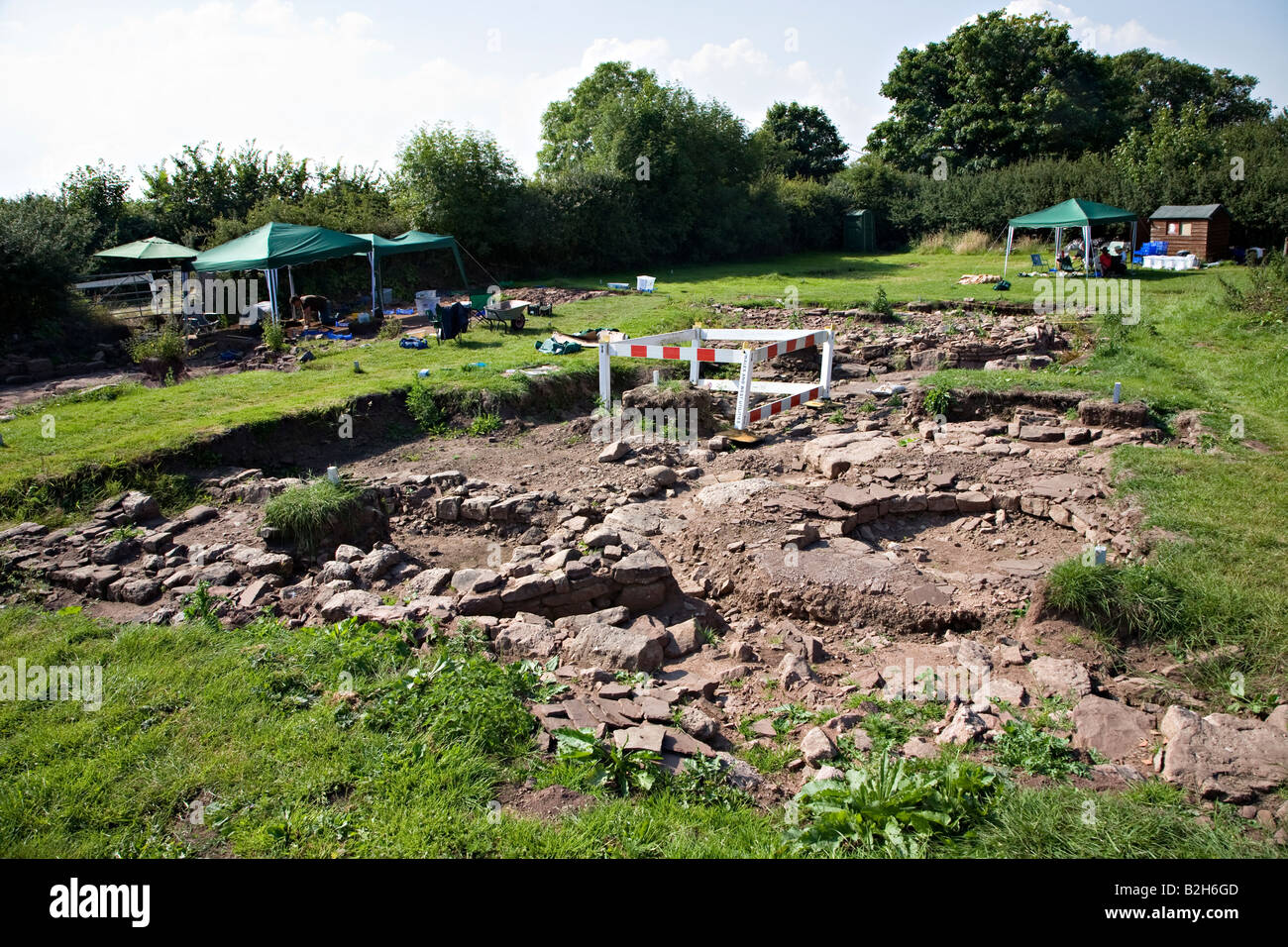 Archaeological dig at the Lost City of Trellech project showing unearthed walls Wales UK - Stock Image