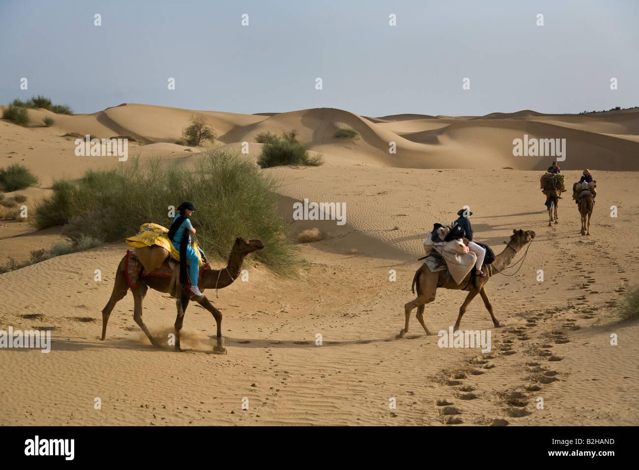 Image of: Dreamstime Travelers Ride Camels Through Sand Dunes In The Thar Desert Near Jaisalmer Rajasthan India Mr Alamy Travelers Ride Camels Through Sand Dunes In The Thar Desert Near