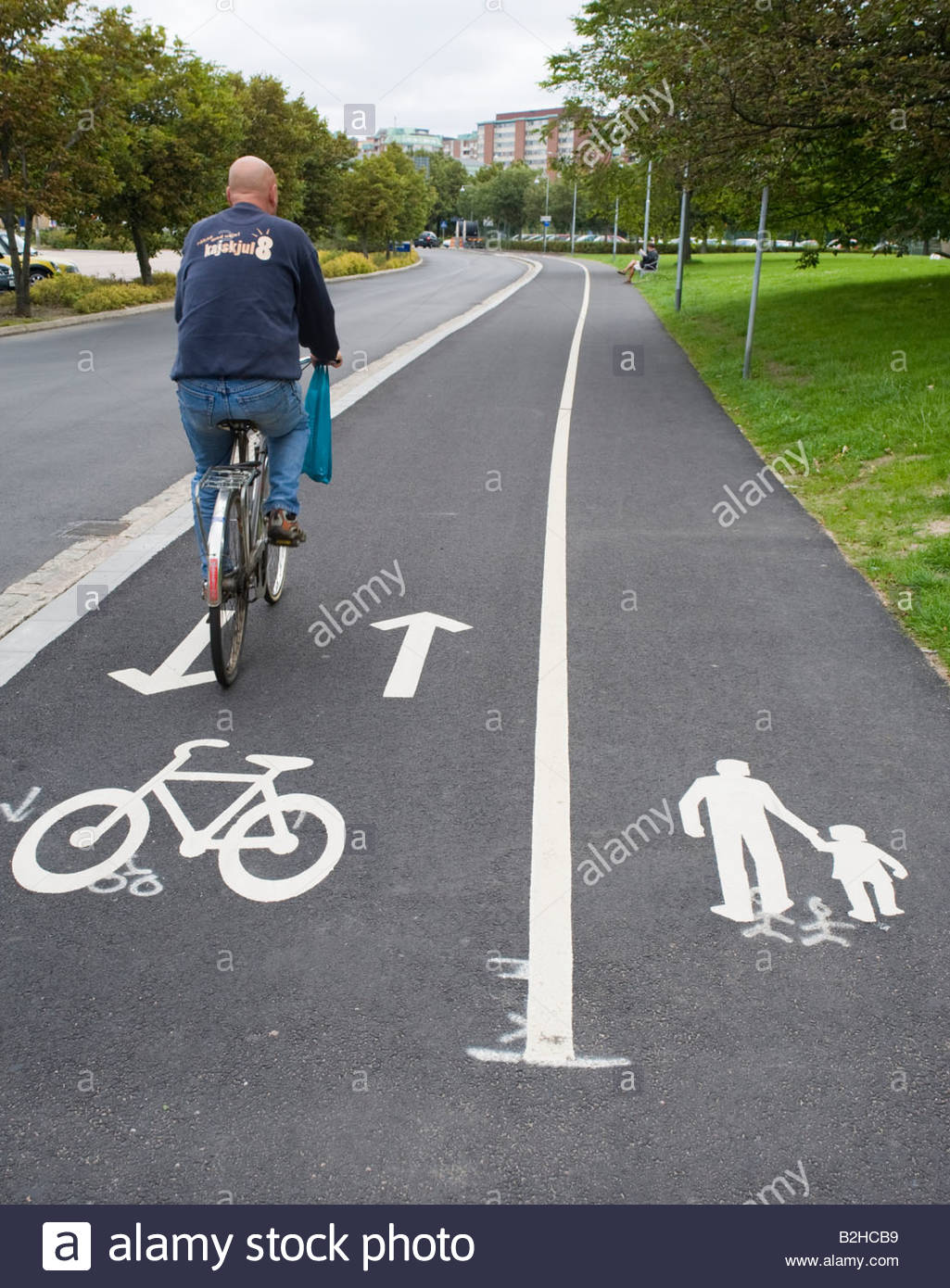Painted sign on footpath to indicate segregated lanes for walking and cycling in Sweden 2008 - Stock Image