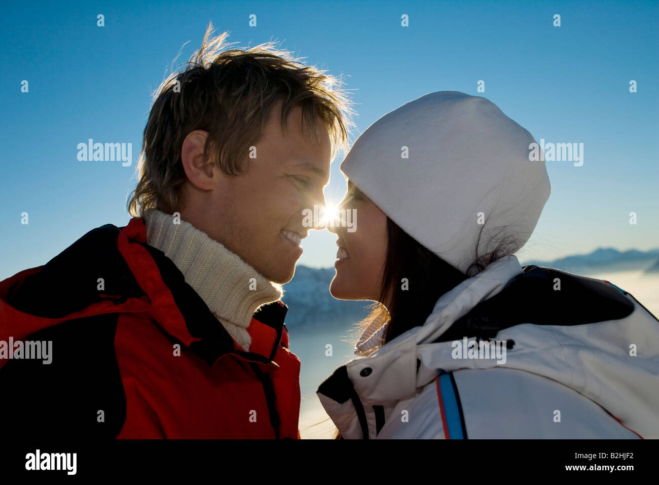 young couple in the mountains tenderly looking at each other - Stock Image