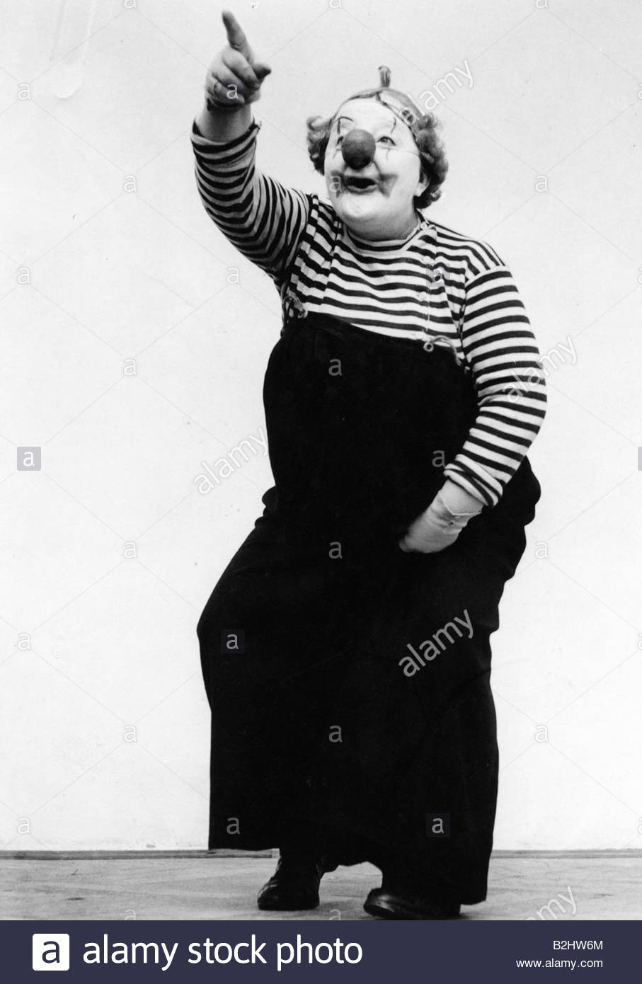 circus, Jany Cox as clown, 20th century, cinema, pointing with finger in air, disguise, costume, disguised, artist, - Stock Image